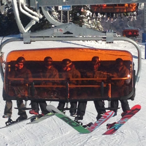 Five snowboarders at Okemo`